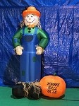 7' Air Blown Inflatable Scarecrow Standing Next To Pumpkin